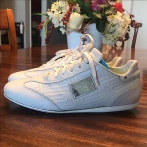 Gianni Versace white sneaker flats.